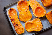 Roasting butternut pumpkin, for a warming soup.  Top view on oven tray.