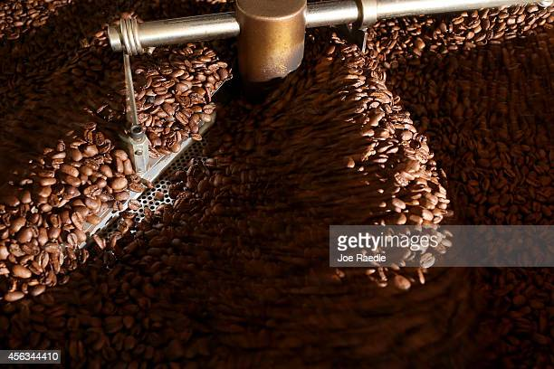 Roasting coffee beans are seen at Eternity Coffee Roasters during National Coffee Day on September 29 2014 in Miami Florida The day is for coffee...