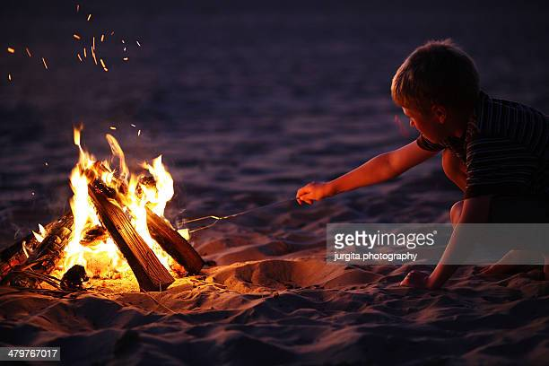 roasting marshmallows on the beach