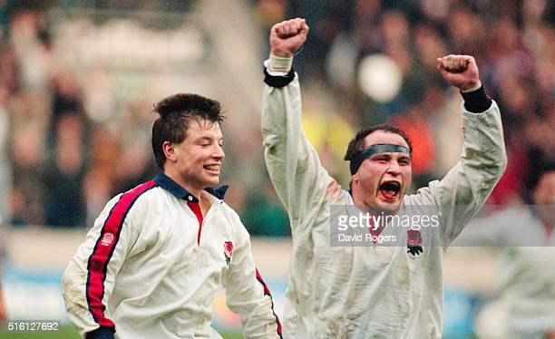 Rob Andrew and Brian Moore celebrate after England had beaten the New Zealand All Blacks 159 at Twickenham on November 27 1993 in London England