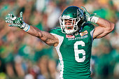 Rob Bagg of the Saskatchewan Roughriders celebrates after making a catch for a first down in the game between the Ottawa Redblacks and the...