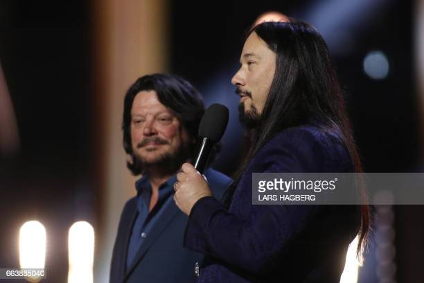 Rob Baker and Paul Langlois of the The Tragically Hip accept the award for Group of the Year during the JUNO awards show at the Canadian Tire Centre...