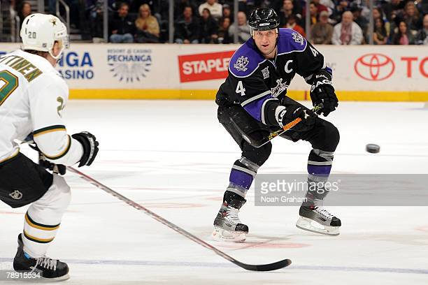 Rob Blake of the Los Angeles Kings makes a pass against Antti Miettinen of the Dallas Stars at Staples Center January 12 2008 in Los Angeles...