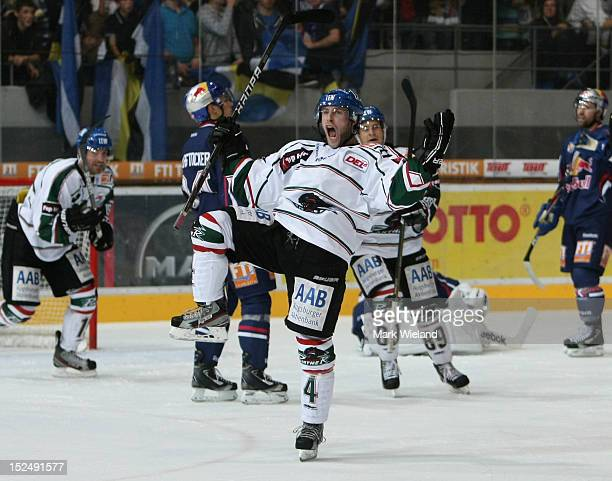 Rob Brown of Augsburger Panthers celebrates scoring their second goal during the DEL match between EHC Muenchen and Augsburg Panther at...