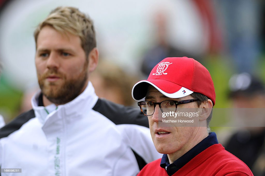 Rob Brydon (R) and Brian McFadden (background) at the Celebrity Golf Club Live event at Celtic Manor Resort on May 12, 2013 in Newport, Wales.