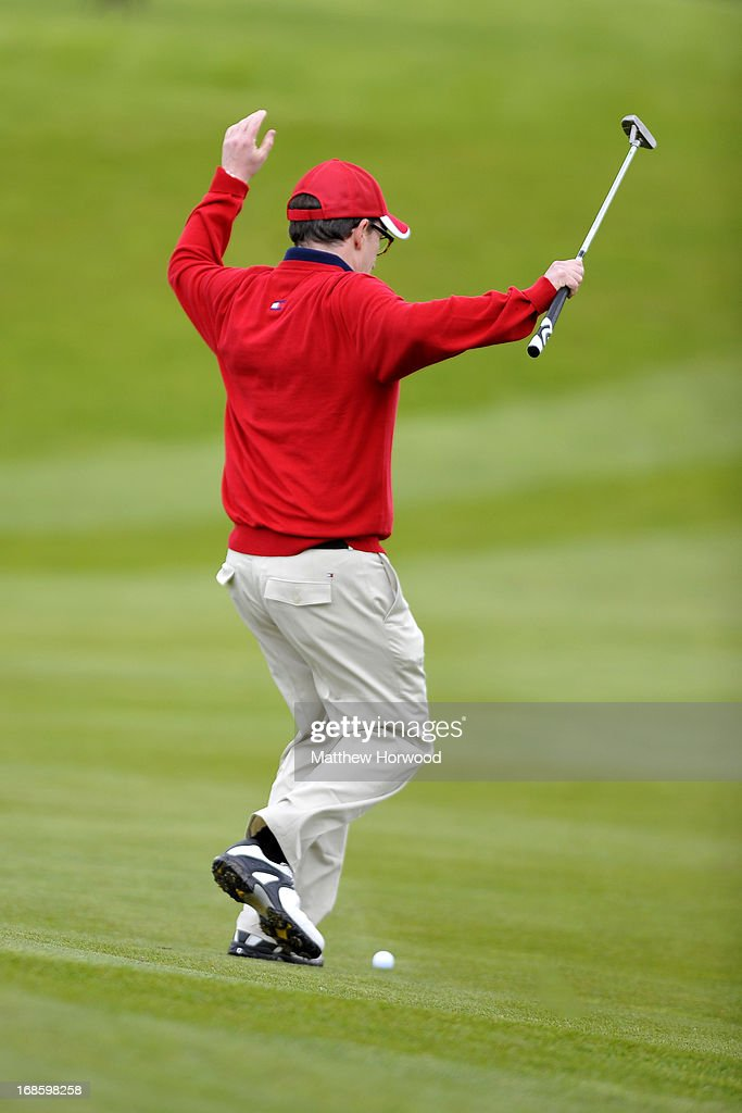 <a gi-track='captionPersonalityLinkClicked' href=/galleries/search?phrase=Rob+Brydon&family=editorial&specificpeople=618673 ng-click='$event.stopPropagation()'>Rob Brydon</a> chases his ball as it rolls off the green at the Celebrity Golf Club Live event at Celtic Manor Resort on May 12, 2013 in Newport, Wales.