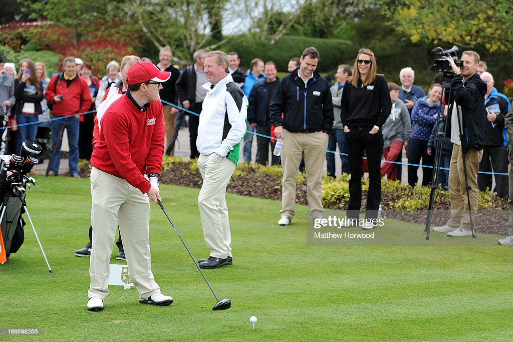 <a gi-track='captionPersonalityLinkClicked' href=/galleries/search?phrase=Rob+Brydon&family=editorial&specificpeople=618673 ng-click='$event.stopPropagation()'>Rob Brydon</a> jokingly turns the ball on the crowd at the Celebrity Golf Club Live event at Celtic Manor Resort on May 12, 2013 in Newport, Wales.
