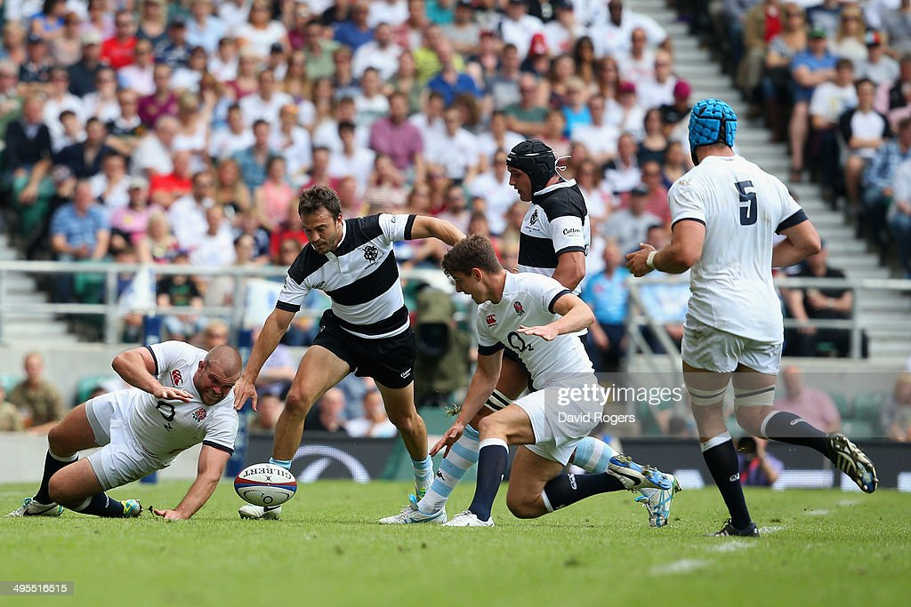 Rob Buchanan of England and Juan Martin Hernandez of the Barbarian scramble for the ball during the Rugby Union International Match between England and The Barbarians at Twickenham Stadium on June 1, 2014 in London, England.