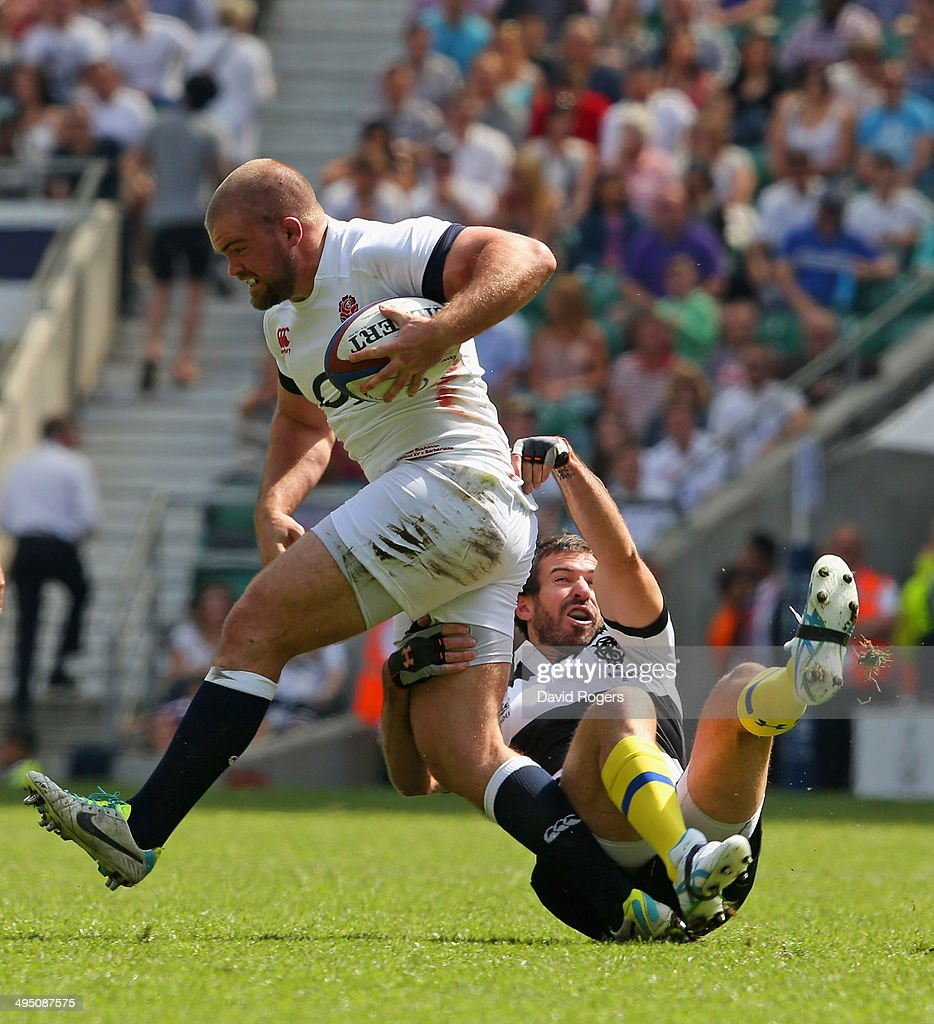 Rob Buchanan of England evades the tackle from <a gi-track='captionPersonalityLinkClicked' href=/galleries/search?phrase=Brock+James&family=editorial&specificpeople=636412 ng-click='$event.stopPropagation()'>Brock James</a> of the Barbarians during the Rugby Union International Match between England and The Barbarians at Twickenham Stadium on June 1, 2014 in London, England.
