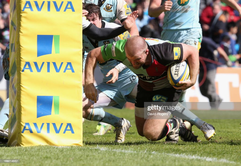 Rob Buchanan of Harlequins dives against the foot of the post to score a try during the Aviva Premiership match between Harlequins and Northampton Saints at Twickenham Stoop on May 4, 2013 in London, England.