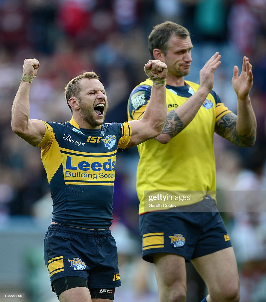 Rob Burrow and Jamie Peacock of Leeds celebrate winning the Carnegie Challenge Cup Semi Final match between Leeds Rhinos and Wigan Warriors at Galpharm Stadium on July 14, 2012 in Huddersfield, England.