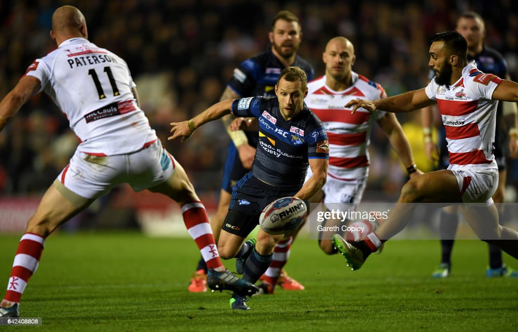 Rob Burrow of Leeds kicks past Cory Paterson of Leigh during the Betfred Super League match between Leigh Centurions and Leeds Rhinos at Leigh Sports Village on February 17, 2017 in Leigh, Greater Manchester.