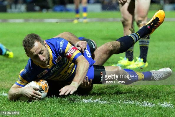 Rob Burrow of Leeds Rhinos crosses over to score his teams first try during the World Club Series match between Leeds Rhinos and North Queensland...