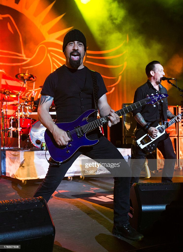 Rob Caggiano (L) and <a gi-track='captionPersonalityLinkClicked' href=/galleries/search?phrase=Michael+Poulsen&family=editorial&specificpeople=5821230 ng-click='$event.stopPropagation()'>Michael Poulsen</a> of Volbeat performs during the Rock Allegiance Tour at Freedom Hill Amphitheater on August 28, 2013 in Sterling Heights, Michigan.