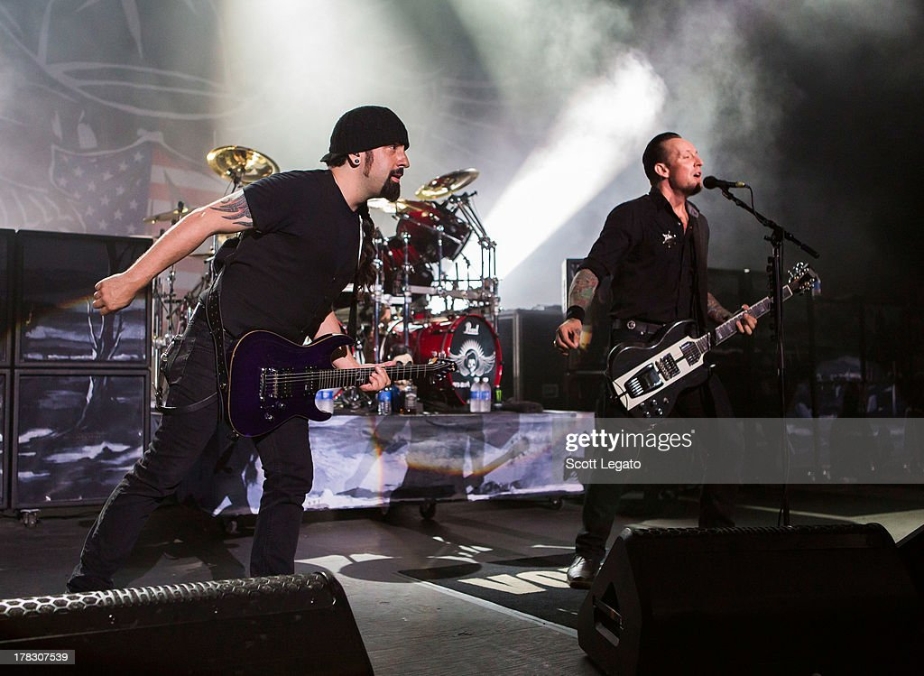 Rob Caggiano (L) and Michael Poulsen of Volbeat performs during the Rock Allegiance Tour at Freedom Hill Amphitheater on August 28, 2013 in Sterling Heights, Michigan.