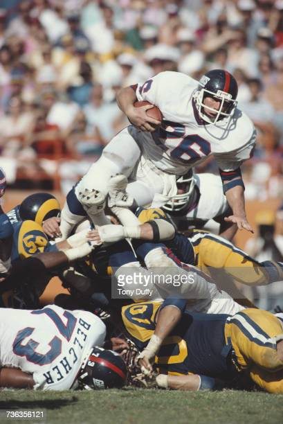 Rob Carpenter running back for the New York Giants carries the ball through a tackle by the Los Angeles Rams defence during their National Football...