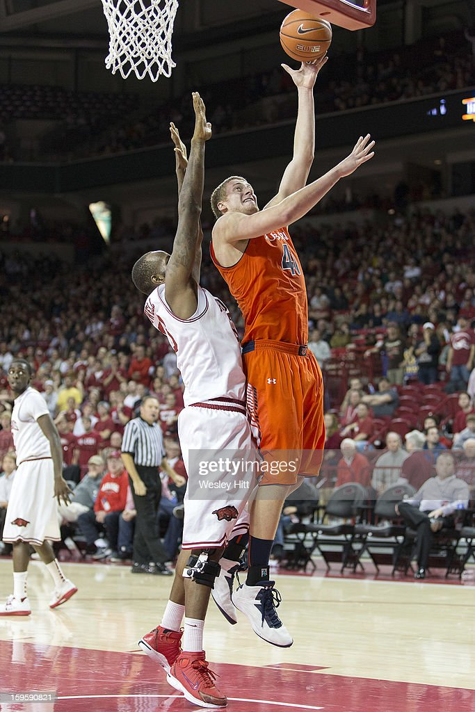 Rob Chubb #41 of the Auburn Tigers goes up for a basket against Marshawn Powell #33 of the Arkansas Razorbacks at Bud Walton Arena on January 16, 2013 in Fayetteville, Arkansas. The Razorbacks defeated the Tigers 88-80.