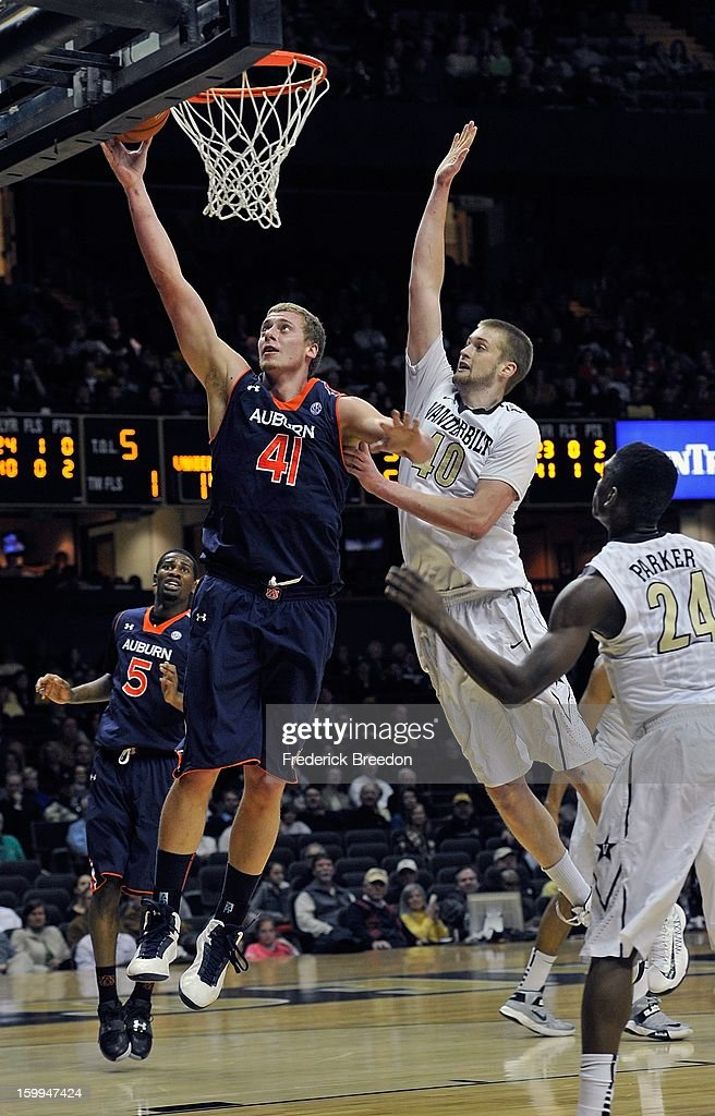 Rob Chubb #41 of the Auburn Tigers goes up for a layup past the defense of <a gi-track='captionPersonalityLinkClicked' href=/galleries/search?phrase=Josh+Henderson+-+Basketball+Player&family=editorial&specificpeople=15212566 ng-click='$event.stopPropagation()'>Josh Henderson</a> #40 of the Vanderbilt Commodores at Memorial Gym on January 23, 2013 in Nashville, Tennessee.