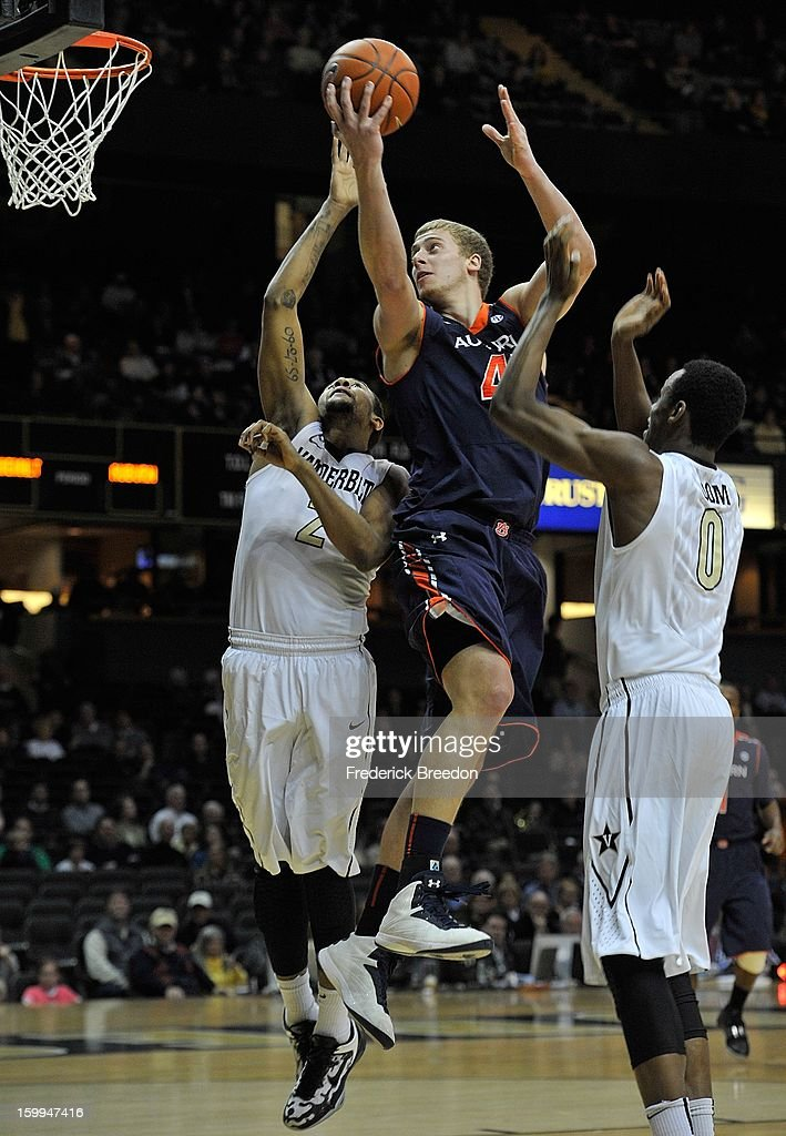 Rob Chubb #41 of the Auburn Tigers goes up for a shot over Kedren Johnson #2 of the Vanderbilt Commodores at Memorial Gym on January 23, 2013 in Nashville, Tennessee.