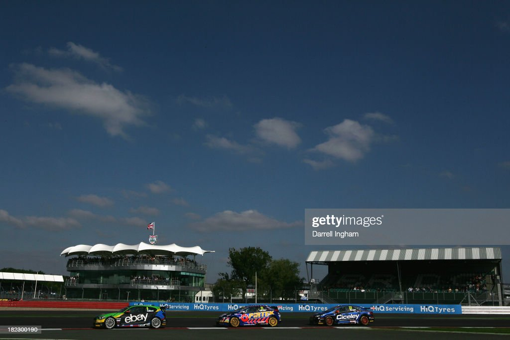Rob Collard drives the #5 eBay Motors BMW 125i M Sport ahead of Andrew Jordan #77 and Adam Morgan during the Dunlop MSA British Touring Car Championship race at the Silverstone Circuit on September 28, 2013 in Towcester, United Kingdom.