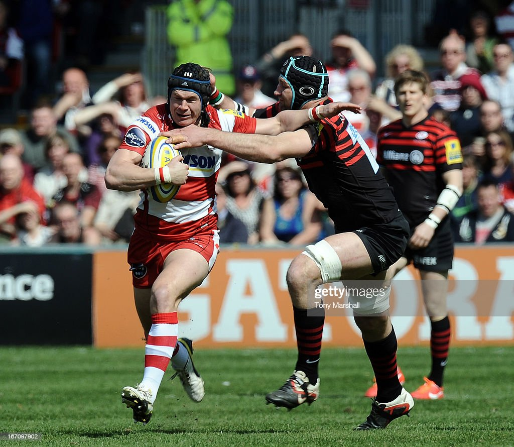 Rob Cook of Gloucester tackled by Steve Borthwick of Saracens during the Aviva Premiership match between Gloucester and Saracens at Kingsholm Stadium on April 20, 2013 in Gloucester, England.