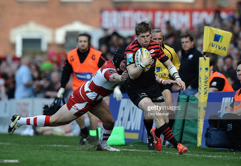 Rob Cook of Gloucester tackles David Strettle of Saracens during the Aviva Premiership match between Gloucester and Saracens at Kingsholm Stadium on April 20, 2013 in Gloucester, England.