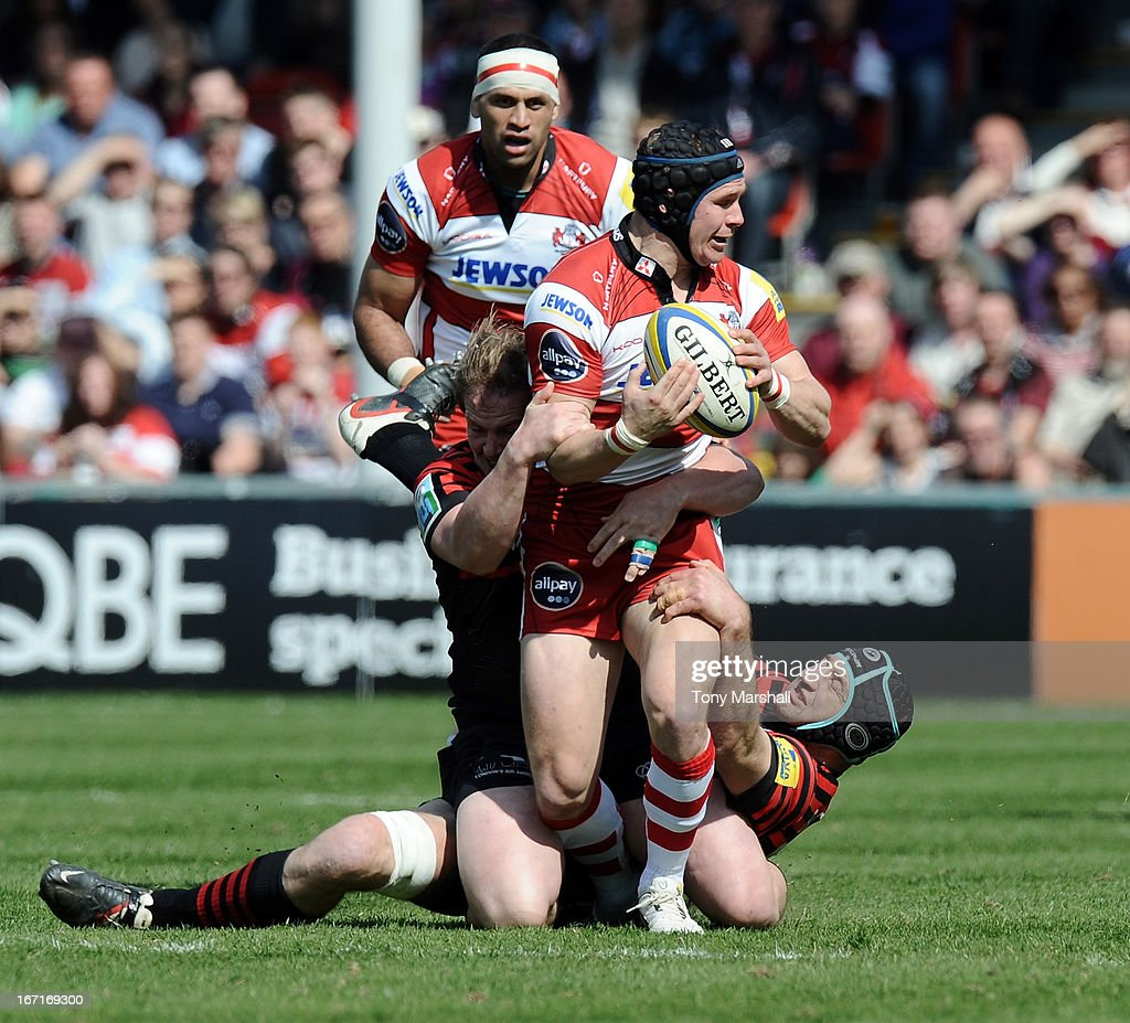 Rob Cook of Gloucestertackled by Rhys Gill(left) and Steve Borthwick (right) of Saracens during the Aviva Premiership match between Gloucester and Saracens at Kingsholm Stadium on April 20, 2013 in Gloucester, England.