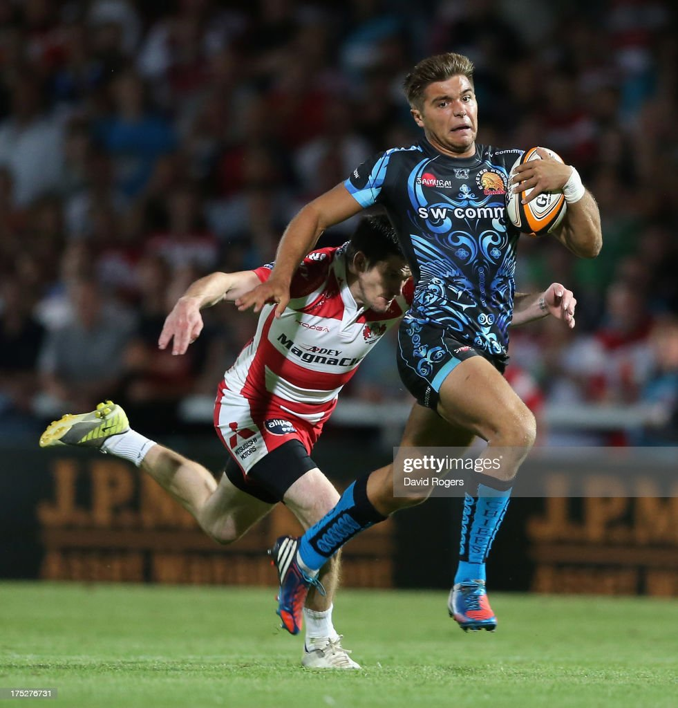 Rob Coote of Exeter Chiefs is chased down by Rhodri McAtee of Gloucester during the J.P. Morgan Asset Management Premiership Rugby 7's held at Kingsholm Stadium on August 1, 2013 in Gloucester, England.
