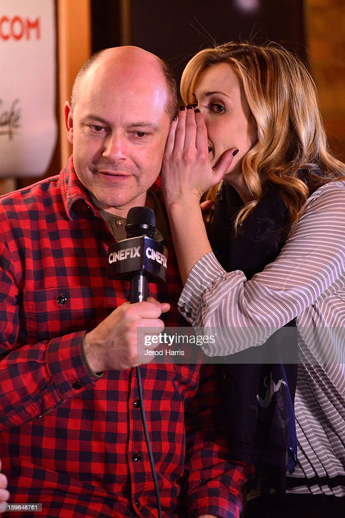 Rob Corddry and Leslie Bibb warm up at the McDonald's McCafe at Sundance on January 21, 2013 in Park City, Utah.