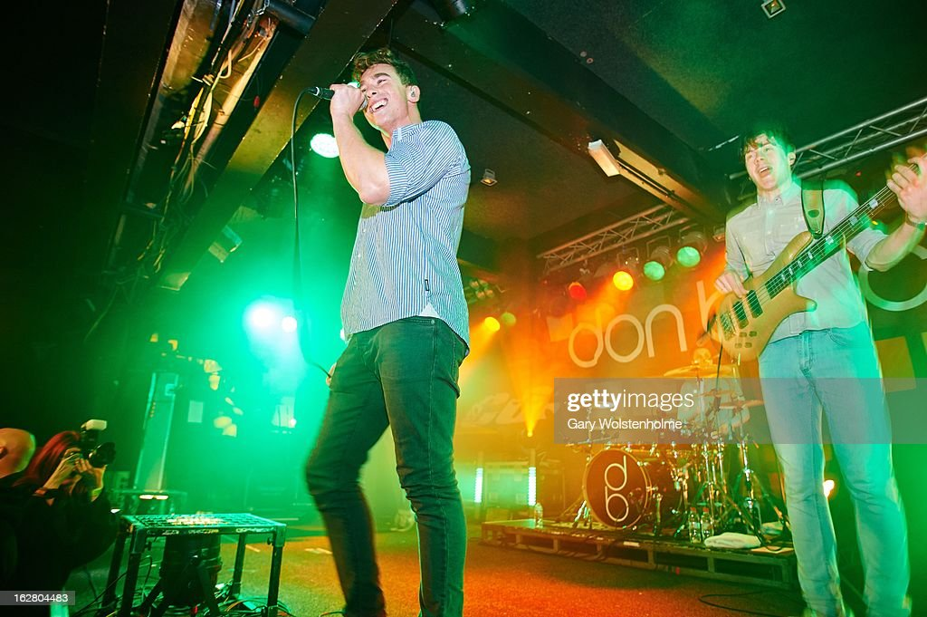 Rob Damiani and <a gi-track='captionPersonalityLinkClicked' href=/galleries/search?phrase=Tom+Doyle+-+Musician&family=editorial&specificpeople=15154779 ng-click='$event.stopPropagation()'>Tom Doyle</a> of Don Broco performs on stage at the Corporation on February 27, 2013 in Sheffield, England.
