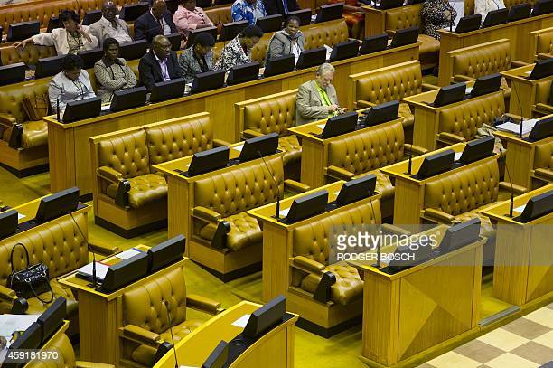 Rob Davies the South African Minister of Trade and Industry sits alone in the front benches in the South African Parliament where the senior members...