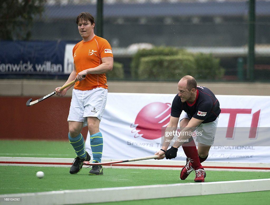 Rob Derikx #5 the Air Team (Holland) (L) waits while Ben Hawes #7 Captain of the Water Team (Great Britain) hits a long shot during Day Three of the 2013 Hong Kong 6's at Hong Kong Football Club on March 30, 2013 in Hong Kong, Hong Kong.