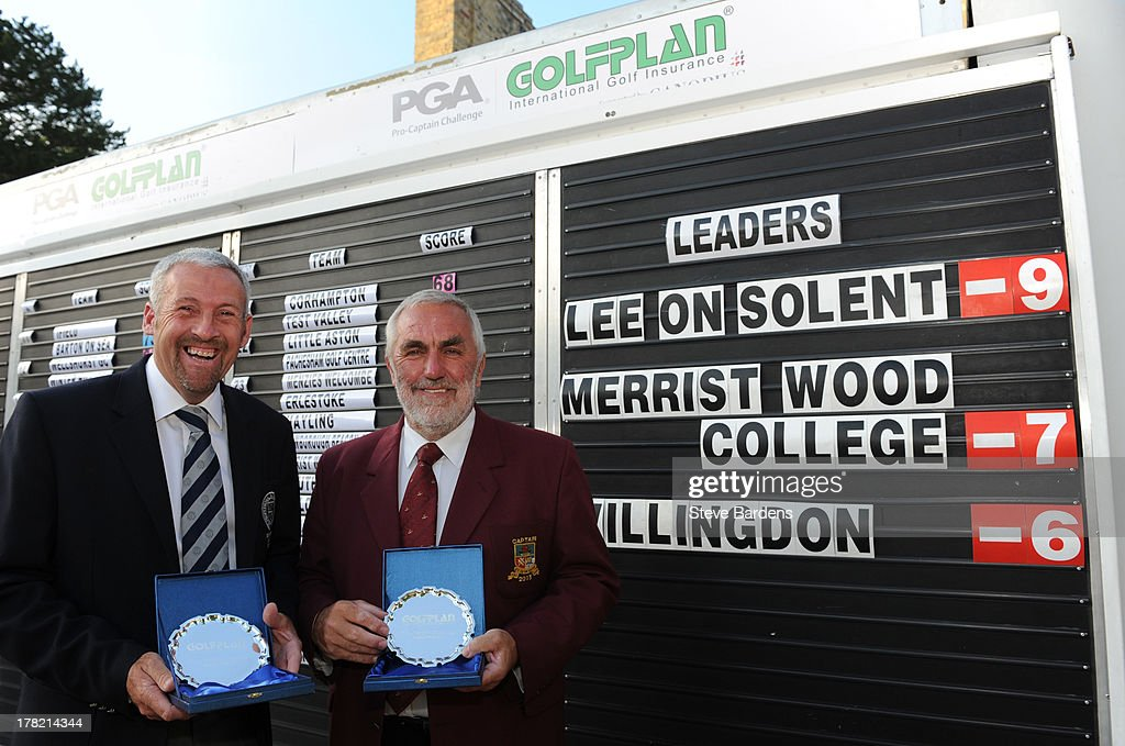 Rob Edwards (L) and Michael Izzard (A) of Lee-on-the-Solent golf club celebrate their victory after the Golfplan Challenge Regional Qualifier at Golf at Goodwood on August 27, 2013 in Chichester, England.