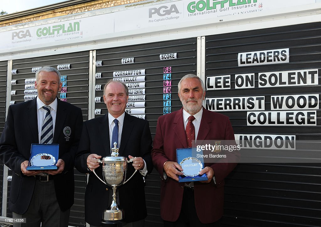 Rob Edwards (L) with Roger Harvey of Golfplan and Michael Izzard (A) of Lee-on-the-Solent golf club celebrate their victory after the Golfplan Challenge Regional Qualifier at Golf at Goodwood on August 27, 2013 in Chichester, England.