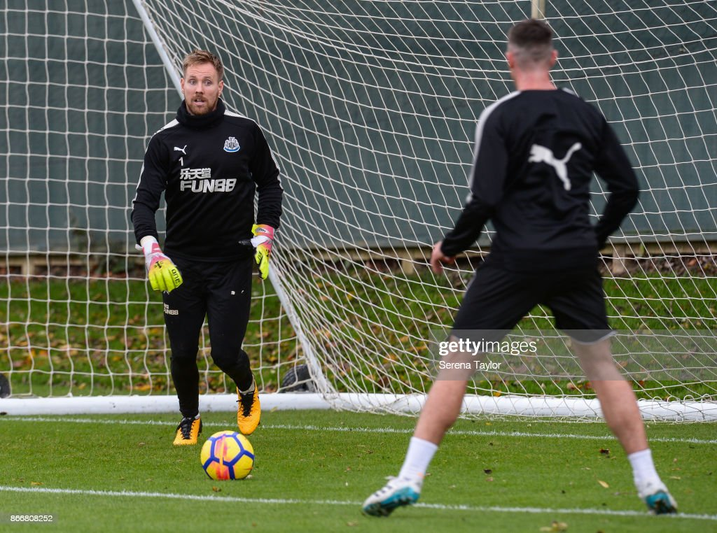 Rob Elliot (L) looks to pass the ball during the Newcastle United Training Session at The Newcastle United Training Centre on October 26, 2017, in Newcastle, England.