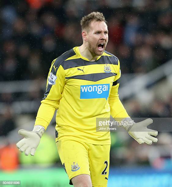 Rob Elliot of Newcastle United celebrates Aleksandar Mitrovic scoring their second goal during the Barclays Premier League match between Newcastle...