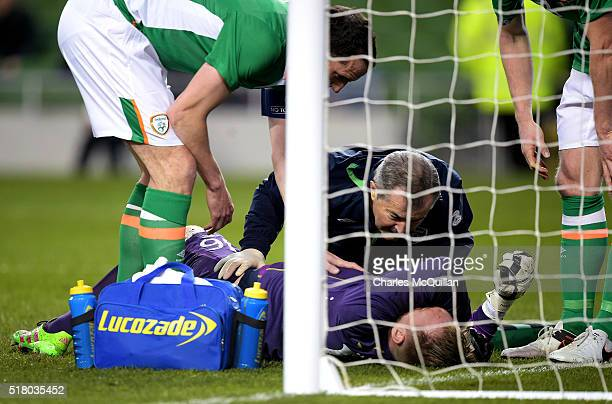 Rob Elliot of the Republic of Ireland suffers a suspected serious injury during the international friendly match between the Republic of Ireland and...
