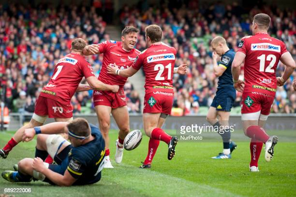 Rob Evans DTH van der Merwe and Jonathan Evans of Scarlets celebrate after scoring during the Guinness PRO12 Final between Munster Rugby and Scarlets...
