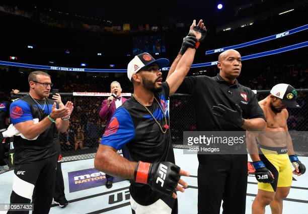 Rob Font celebrates his victory over Douglas Silva de Andrade of Brazil in their bantamweight bout during the UFC 213 event at TMobile Arena on July...