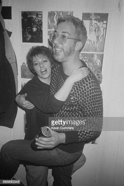 Rob Gretton manager of English rock group New Order with his girlfriend Lesley Gilbert at The Hacienda nightclub in Manchester 1984