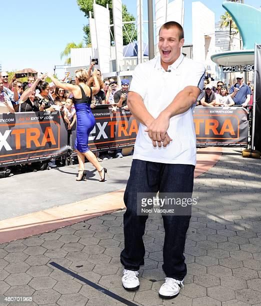 Rob Gronkowski and Charissa Thompson dance at 'Extra' at Universal Studios Hollywood on July 14 2015 in Universal City California