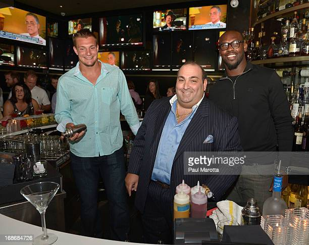 Rob Gronkowski Nick Varano and Chandler Jones serve guests at 'Shaking It Up' Event Benefiting The One Fund Boston at Strega Water Front Bar on May...