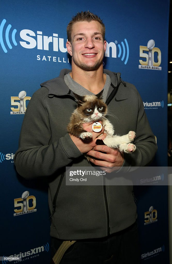 Rob Gronkowski of the New England Patriots and Grumpy Cat attend SiriusXM at Super Bowl 50 Radio Row at the Moscone Center on February 4 2016 in San...