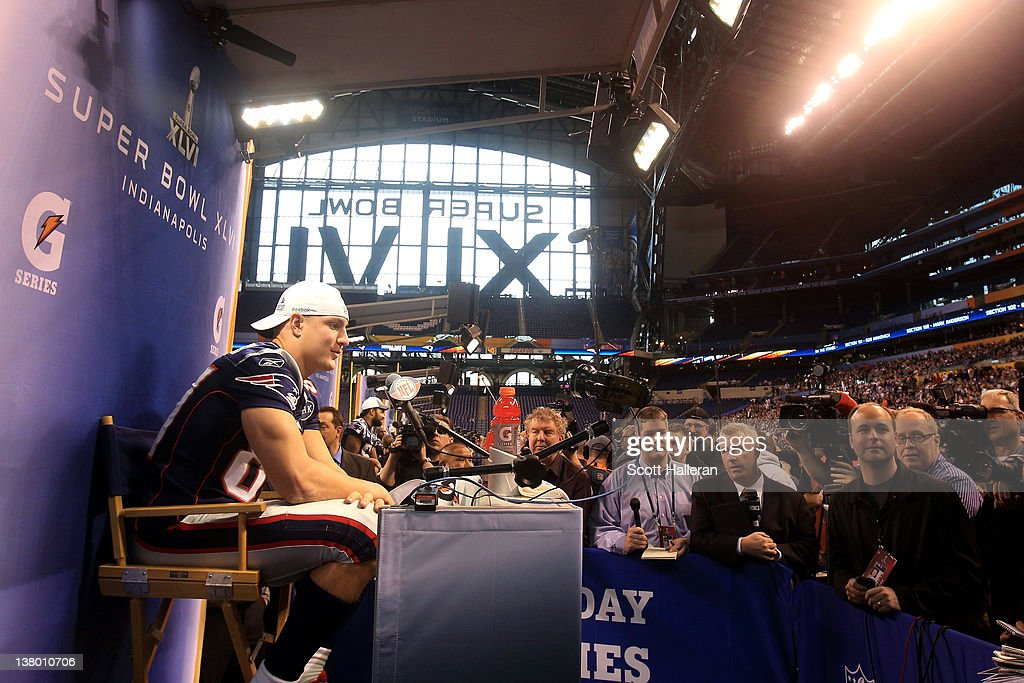 Rob Gronkowski #87 of the New England Patriots answers questions from the media during Media Day ahead of Super Bowl XLVI against the New York Giants at Lucas Oil Stadium on January 31, 2012 in Indianapolis, Indiana.