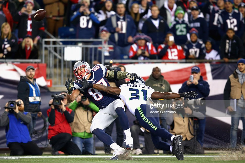 Rob Gronkowski #87 of the New England Patriots attempts to catch a pass as he is defended by Kam Chancellor #31 of the Seattle Seahawks during the first quarter of a game at Gillette Stadium on November 13, 2016 in Foxboro, Massachusetts.
