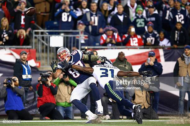Rob Gronkowski of the New England Patriots attempts to catch a pass as he is defended by Kam Chancellor of the Seattle Seahawks during the first...
