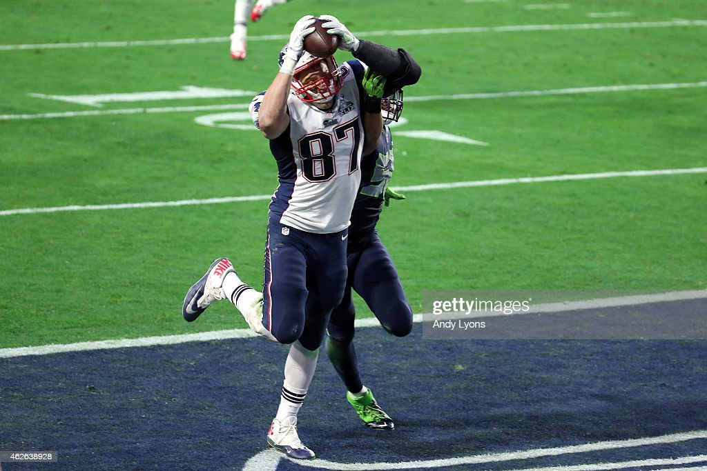 Rob Gronkowski of the New England Patriots catches a 22 yard touchdown against KJ Wright of the Seattle Seahawks in the second quarter during Super...