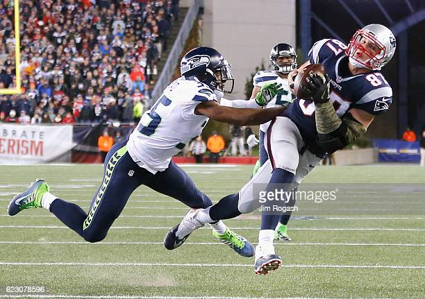 Rob Gronkowski of the New England Patriots catches a pass as he is defended by DeShawn Shead of the Seattle Seahawks during the fourth quarter of a...