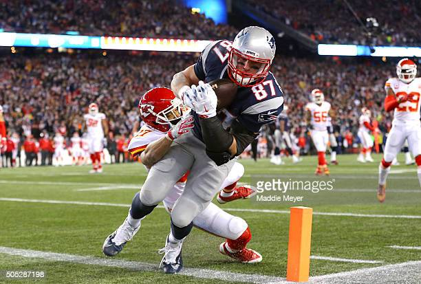 Rob Gronkowski of the New England Patriots catches a touchdown in the third quarter against Tyvon Branch of the Kansas City Chiefs during the AFC...