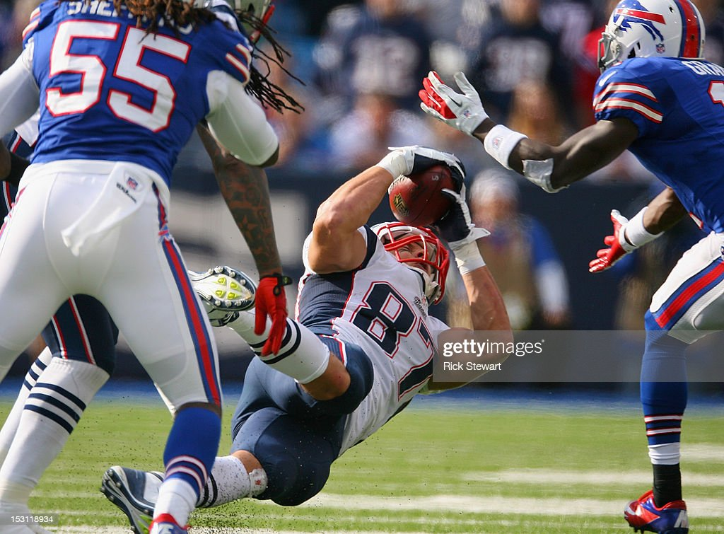 <a gi-track='captionPersonalityLinkClicked' href=/galleries/search?phrase=Rob+Gronkowski&family=editorial&specificpeople=5534525 ng-click='$event.stopPropagation()'>Rob Gronkowski</a> #87 of the New England Patriots catches the ball on a onside kick attempt by the Buffalo Bills at Ralph Wilson Stadium on September 30, 2012 in Orchard Park, New York.